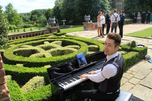 layer-marney-tower-wedding-pianist-piano-music-drinks-reception-outside-e1467220957694
